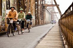 Cycling along Long Bien Bridge