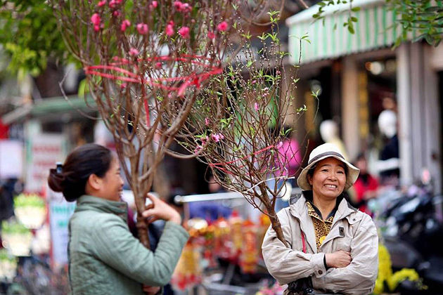 Hanoi people in festive atmosphere of traditional Tet Holiday